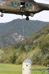 Picture 3: Helicopter transportation of the Aljažev Turret back to the top of Mount Triglav.